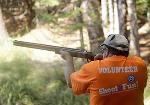 Shoot for Fun volunteer aim at a target